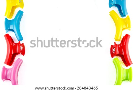 Plastic hair clips isolated on white background - stock photo
