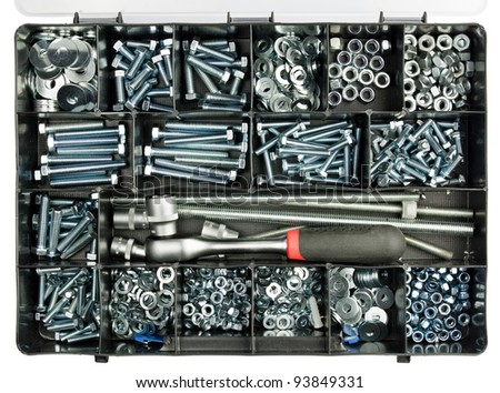 Plastic handyman's toolbox with screws, bolts and some tools. - stock photo