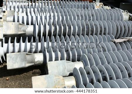 Plastic insulators for high voltage power line - stock photo