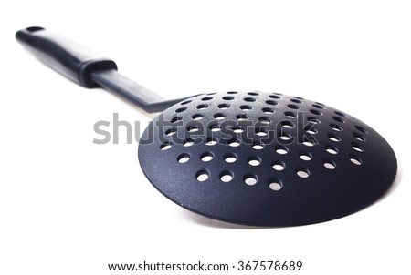 Plastic kitchen utensil on white isolated background