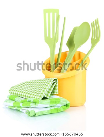 Plastic kitchen utensils in cup isolated on white - stock photo