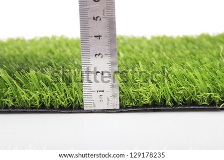 Plastic lawn on a white background - stock photo
