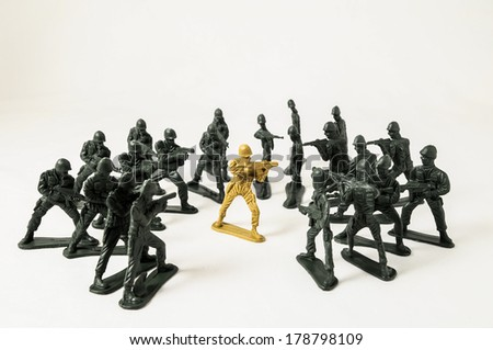 Plastic Lead Soldiers Representing War on a White Background