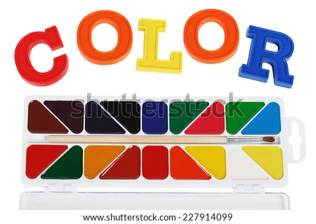 Plastic letters and watercolor paints isolated on white background - stock photo