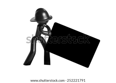 Plastic man in a helmet with a business card - stock photo