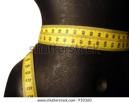 plastic mannequin close-up view with a measuring tape around the waist