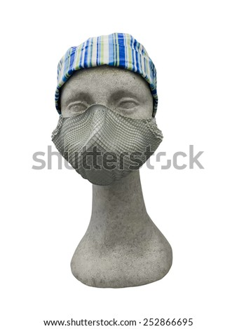 Plastic mannequin wearing protective dust mask with valve - stock photo