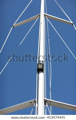 Plastic mast of a sailboat; lowered sails concept - stock photo