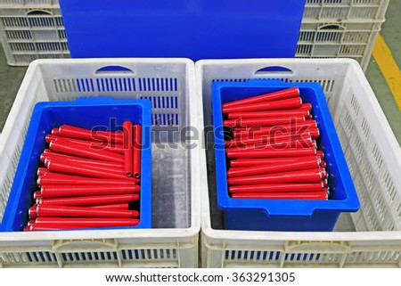 plastic material spindles rollers, closeup of photo