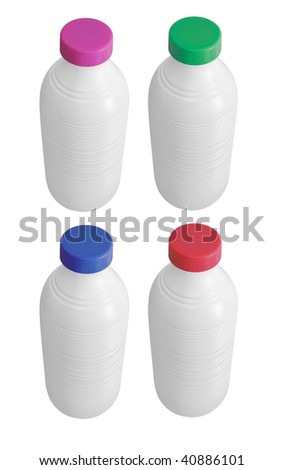 Plastic Milk bottles closed. Each one has a cap in diverse colors - stock photo