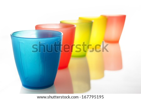 plastic multi-colored glasses isolated on a white  - stock photo