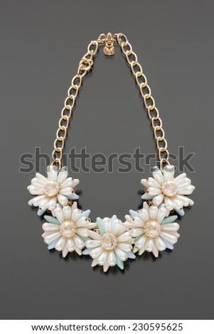 plastic necklace. five beige flower - stock photo