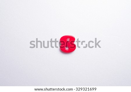 plastic number 8 on the white back ground - stock photo