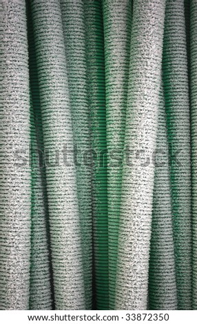 Plastic pipes covered in snow - stock photo