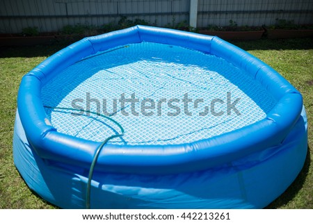 Plastic pool in a summer day outdoors - stock photo
