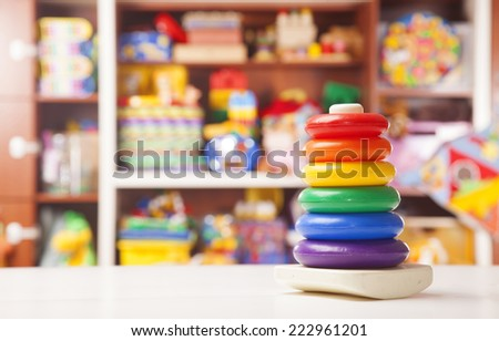 plastic pyramidion in room for children - stock photo
