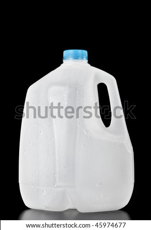 Plastic recyclable water, milk or juice  bottle of one gallon with water drops on the surface