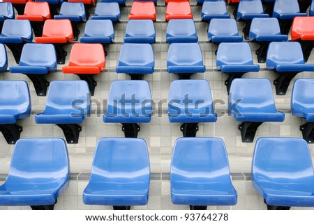 plastic red and blue new chairs in stadium
