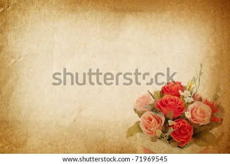 Plastic rose on vintage old paper for text and background