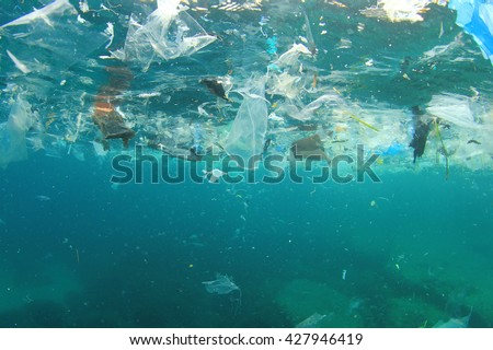 Plastic rubbish pollution in ocean environment - stock photo