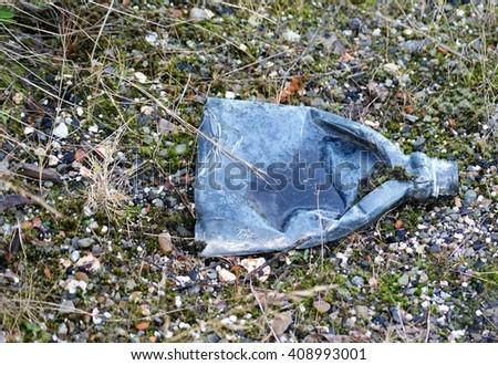 Plastic rubbish thrown away - stock photo