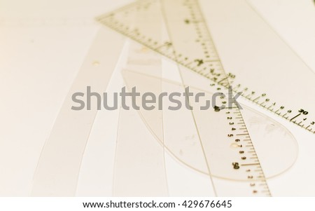Plastic rulers with white background, measurement with centimeters and meters - stock photo