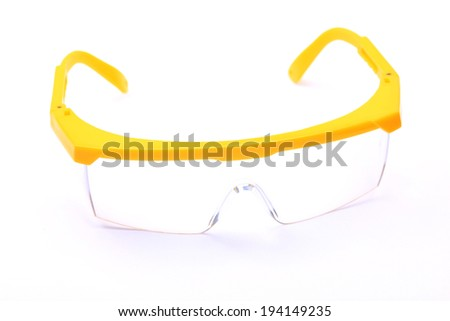 Plastic safety goggles isolated on white - stock photo