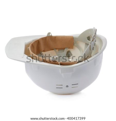 Plastic safety helmet over isolated white background - stock photo