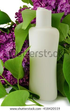 Plastic shampoo bottle on a lilac background - stock photo