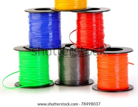 plastic spools isolated on white set with copy space - stock photo