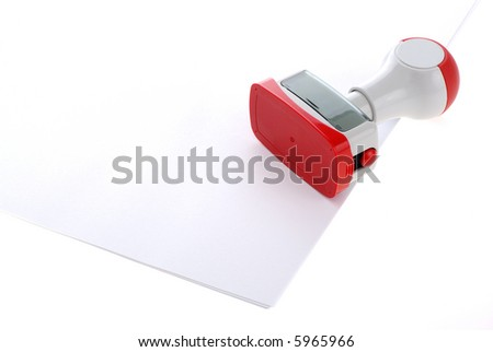 Plastic stamp over white paper