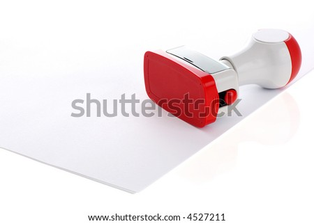 plastic stamp tools isolated over white paper - stock photo