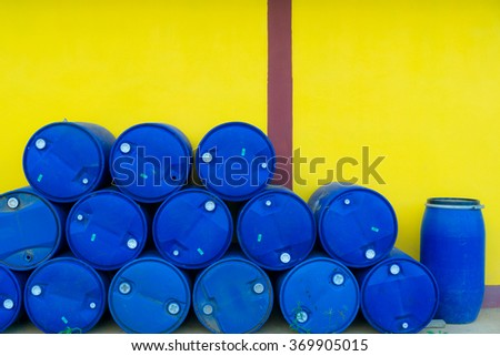 Plastic Storage Drum, Blue Barrel. Isolated on yellow background - stock photo