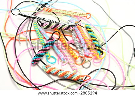 Plastic strings used to make scoubies (boondoggles in USA). Recent craze in UK to make zip pulls, keyfobs etc - stock photo