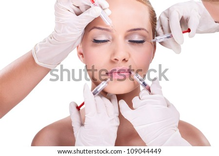 Plastic surgeons giving injection of botox - stock photo