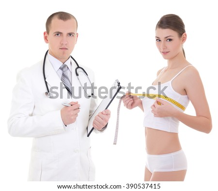 plastic surgery and breast augmentation concept - doctor and beautiful woman patient isolated on white background - stock photo