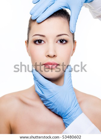 Plastic  surgery touching the beautiful woman face.  Isolated on white - stock photo