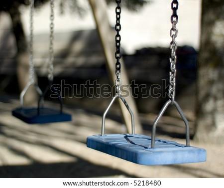 Plastic swings - stock photo