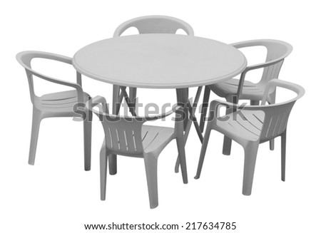 Plastic table and chairs isolated on white. Clipping path included. - stock photo