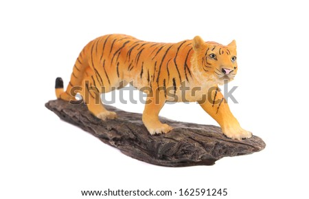 Plastic tiger figurine. Isolated on a white background. - stock photo