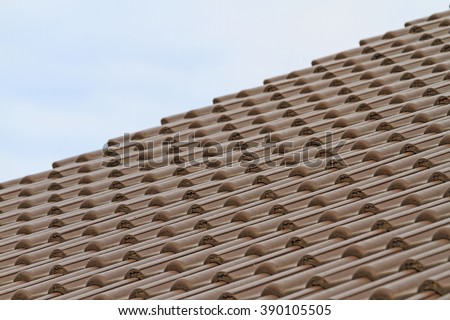 plastic tiles on new home construction, the roof of the dwelling and the sky - stock photo