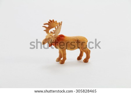 Plastic toy animals on a white background - stock photo