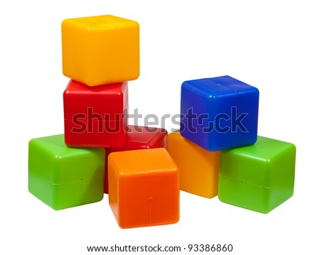 Plastic toy blocks on white background - stock photo