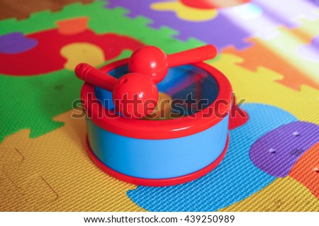 Plastic toy drum with two sticks - stock photo