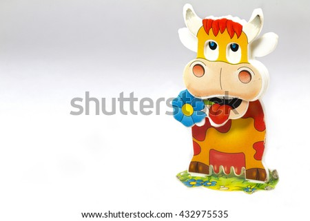 Plastic toy funny articulated cow isolated on white background. - stock photo