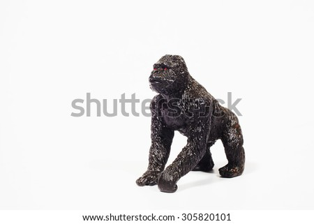 Plastic toy gorilla on a white background