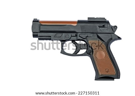Plastic toy gun isolated on a white background