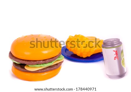 Plastic toy hamburger with bun - stock photo