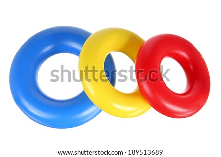 Plastic Toy Rings on White Background - stock photo