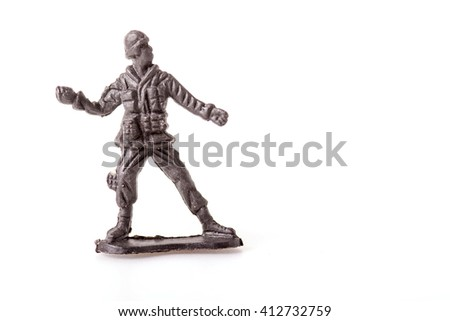Plastic Toy Soldiers on white background - stock photo